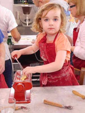 Holly, aged 4, making pasta