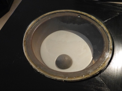Iron ball floating in mercury. The mercury has oxidised hence its milky colour. H&S actually kicked in here - the museum covered the dish with glass as ladies kept dipping their hands in and their rings were melting!