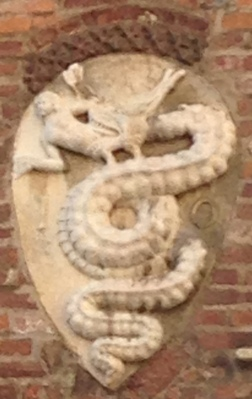 Milan's coat of arms ... a serpent eating the Muslim that Visconti defatted .. he got the keep the cat of arms