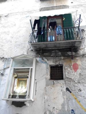 Ex voto shrine, washing and grafitti ... this is Naples.