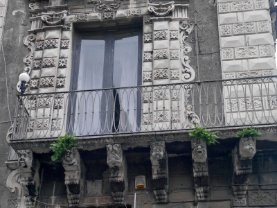 Some of the characterful gargoyles supporting balconies.