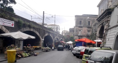 The fruit market leading to the fish market under the arches.